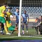 Adam Idah of Norwich scores his sides 2nd goal during the Sky Bet Championship match at Adams Park,