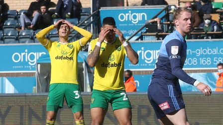 The Norwich players react after Onel Hernandez of Norwich misses a header during the Sky Bet Champio