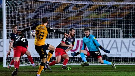 Tom Parkes of Exeter City blocks from Mickey Demetriou of Newport County during the Sky Bet League 2