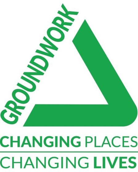 Groundwork South logo with words in shape of green triangle
