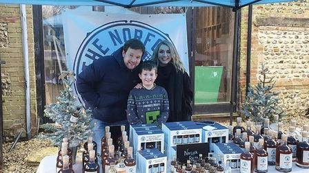 Ben Crisp with son Sebastian Crisp and Lucy Robinson, sister of his partner Helen, at a market with The Norfolk Spirit...