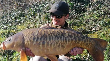 Louie Russell with a mirror carp fromNewbarn