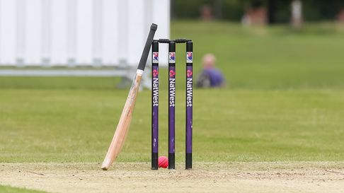 General shot of a set of Herts Cricket League stumps, bat and ball