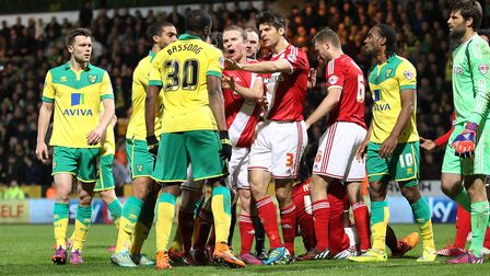 Tempers flare as Sebastien Bassong of Norwich shows his anger at the Middlesbrough time wasting duri