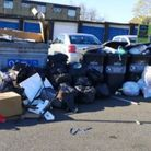 Fly-tipping next to full bins in Stevenage