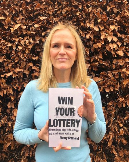 Author Sharry Cramond with her book, Win Your Lottery