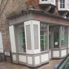 Swass Stickers have been sprayed onto the windows of the Great Wall Chinese Takeaway Restaurant within Huntingdon.