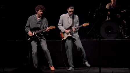 Talking Heads performing live in concert movie Stop Making Sense.