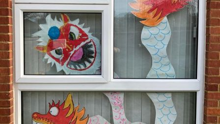 Dragon artwork designed by Woolenwick pupils Isaac and Imogen
