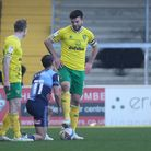 Grant Hanley of Norwich and Oliver Skipp of Norwich let Scott Kashket of Wycombe Wanderers know exac