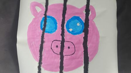 Oliver and Benji paintedposters to raise awareness against factory farming
