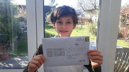 Oliver Furse, 9, with his letter to Daisy Cooper MP. In the letter, Oliver asked for Daisy's support to stop factory farming