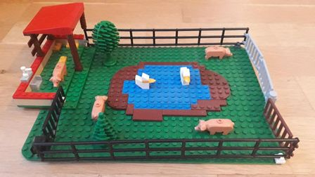 Oliver and Benji's depiction of a free-range 'happy'farm in Lego