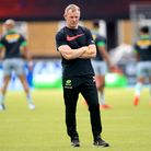 Saracens head coach Mark McCall watches the team warm up prior to the beginning of the Gallagher Pre