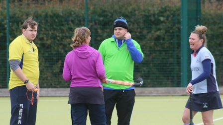 Ladies second team captainPaula Bingham with umpires before a game at St Neots Hockey Club