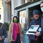 Cllr Adam Jogee, Catherine West MP and Lewis Freeman with Paul Saxton on his final day selling newspapers in Crouch End.
