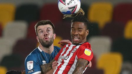 Grant Hanley of Norwich and Ivan Toney of Brentford in action during the Sky Bet Championship match