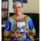Dame Elilzabeth Anionwu with her book 'Mixed Blessing from a Cambridge Union'. Picture: Northwick Pa