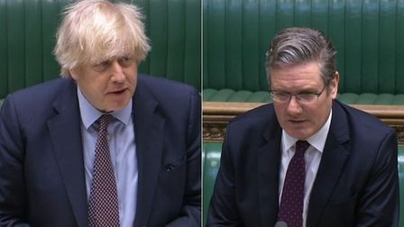 Boris Johnson (L) and Sir Keir Starmer in the House of Commons