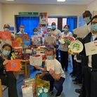 Staff at King George Hospital with the 200 gifts donated through Mayepark Primary School's charity drive to honour Sir Tom Moore.