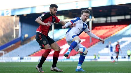 Coventry City's Maxime Biamou (left) and Blackburn Rovers' Tom Trybull (right) battle for the ball d