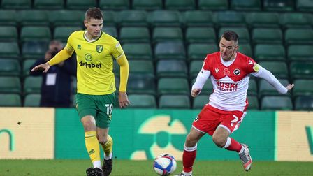 Jacob Sorensen of Norwich and Jed Wallace of Millwall in action during the Sky Bet Championship matc