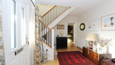 The large, bright and airy hallway of the property in Clevedon Road, Tickenham. It has a white UPVC door on the left, red...