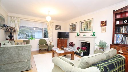 The sitting room in the property for sale in Clevedon Road Tickenham has beige and cream sofas, a square wooden coffee...