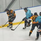 Raiders forward Tommy Huggett on the puck against Sheffield Steeldogs at the Sapphire Ice and Leisure Centre