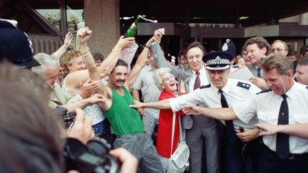 Comedian Ken Dodd celebrates with supporters after being acquitted of tax evasion charges at Liverpool Crown Court