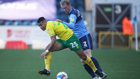 Jack Grimmer of Wycombe Wanderers gets to grips with Onel Hernandez of Norwich during the Sky Bet Ch