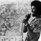 Gil Scott Heron performing on stage