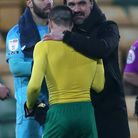 Daniel Farke has a hug for Norwich City's Brentford match winner, Emi Buendia, after moving 10 points clear at the top of the Championship