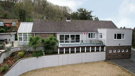 single-storey building with conservatory on the left side and parking area and driveway in front for sale in Dark Lane...