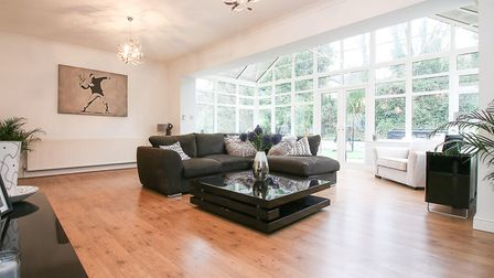 The detached property in Dark Lane, Banwell, Weston-super-Mare has a lovely sitting room with wooden floor, white walls...