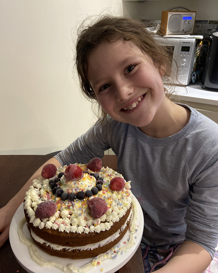 Ruby Creen jumped to get involved in the NHS fundraiser with a huge cake.