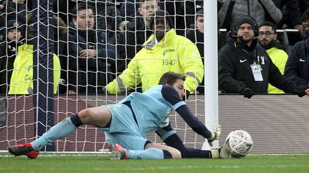 Tim Krul of Norwich saves a penalty from Gedson Fernandes of Tottenham Hotspur to send his side into