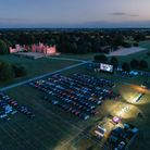 An aerial drone shot of The Luna Cinema's drive-in movies event at Knebworth House.