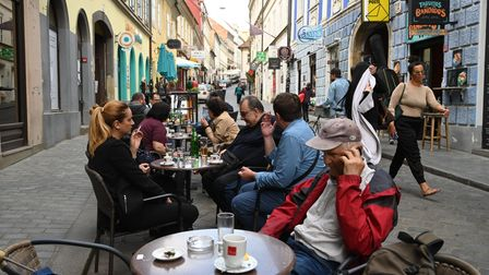 Customers on the terrace of a cafe in Zagreb, in May 2020