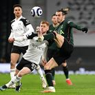 Fulham's Harrison Reed and Tottenham Hotspur's Gareth Bale (right) battle for the ball