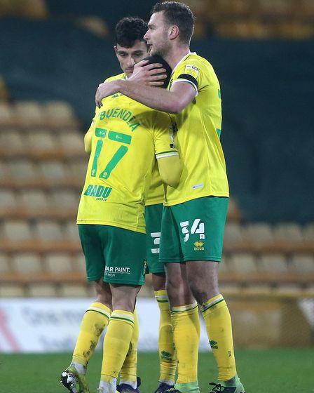 Ben Gibson of Norwich and Emiliano Buendia of Norwich at the end of the Sky Bet Championship match a