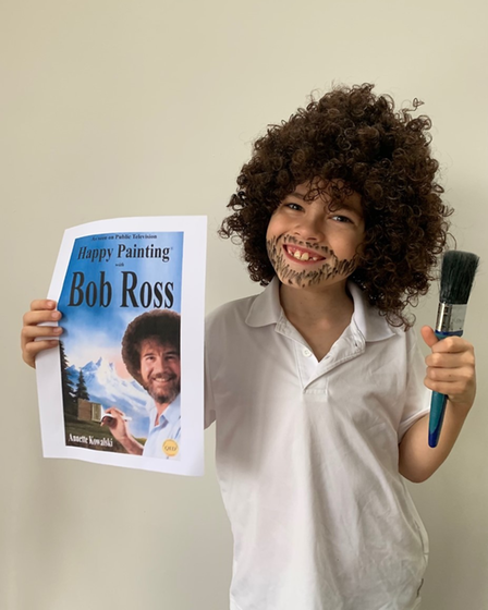 Eight-year-old Ollie Sheard, who attends Cunningham Hill Junior School, dressed as American painter Bob Ross, inspired by...