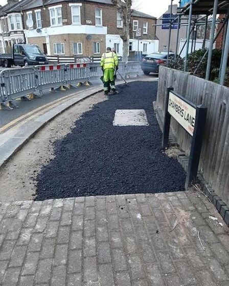 Chambers Lane being asphalted despite huge opposition by locals. Picture: Sonia Locke