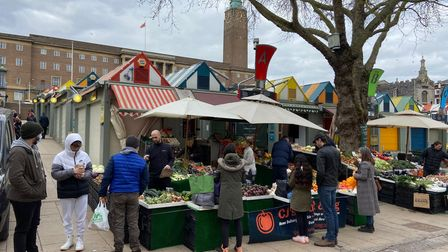 Norwich Market stalls were still drawing customers despite lockdown.