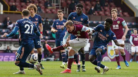Burnley's Johann Berg Gudmundsson is surrounded by the Arsenal defence as he shoots towards goal dur
