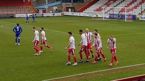 Stevenage celebrate Elliot List's opener against Harrogate Town