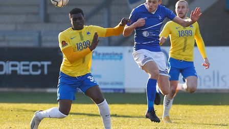 Josh Umerah of Torquay United challenges for the aerial ball with Lewis Cass of Hartlepool United du
