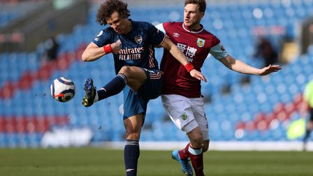 Arsenal's David Luiz and Burnley's Chris Wood (right) battle for the ball during the Premier League