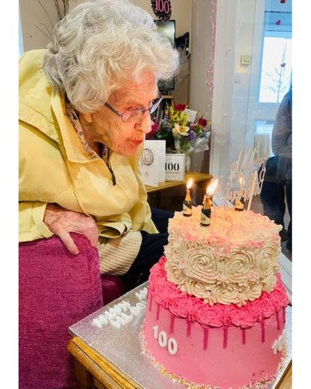 Kathleen Cage blowing out her 100th birthday candles