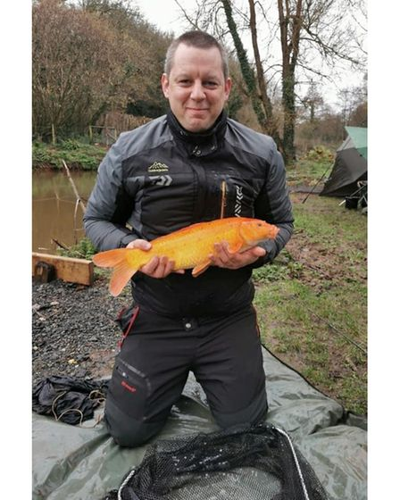 Johnathon Selley with a golden koi from Spring Ponds